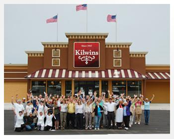 The Kilwins team members wave to the camera outside of the Kilwins store