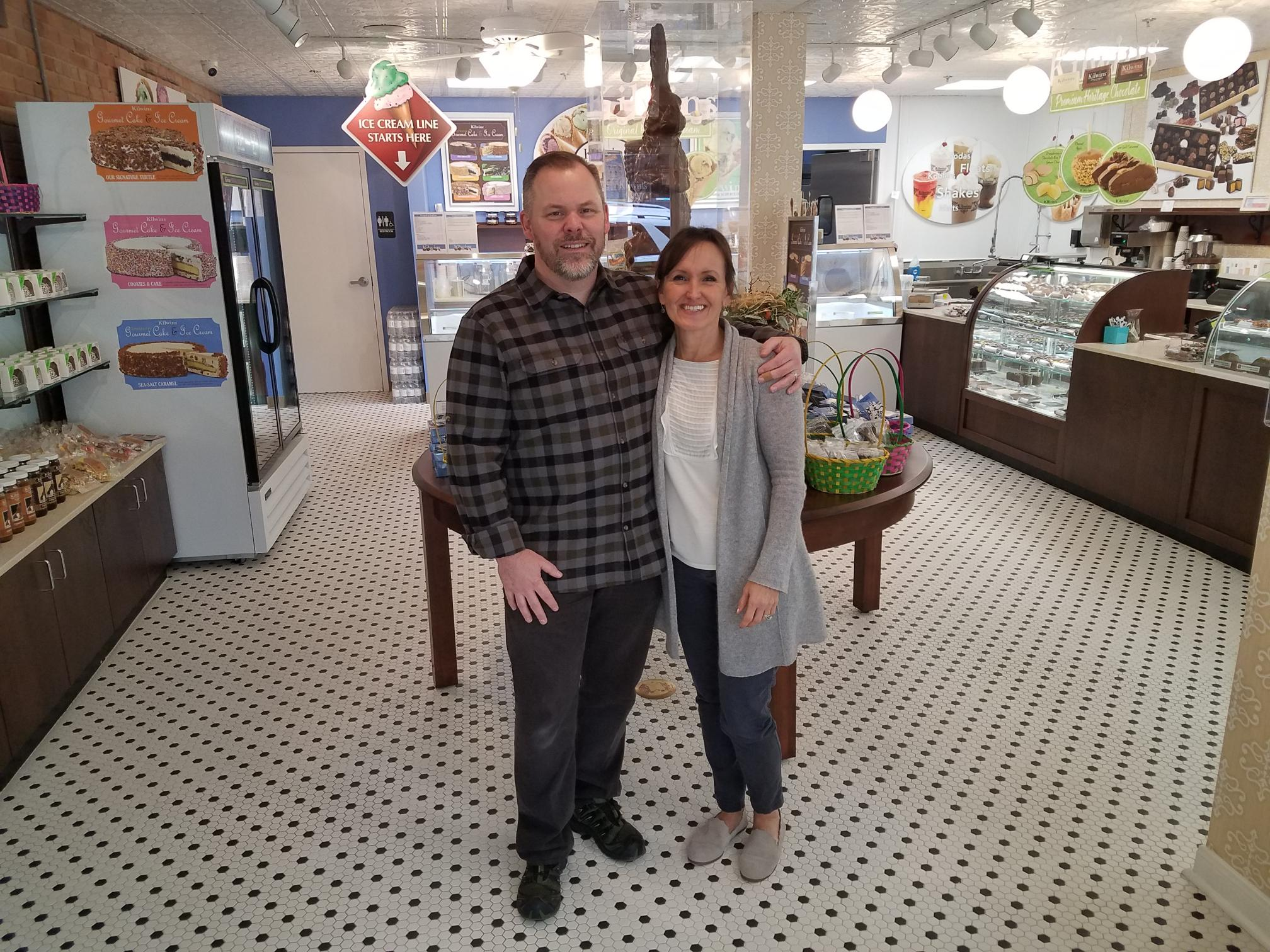 A picture of the owners inside the Grapevine store