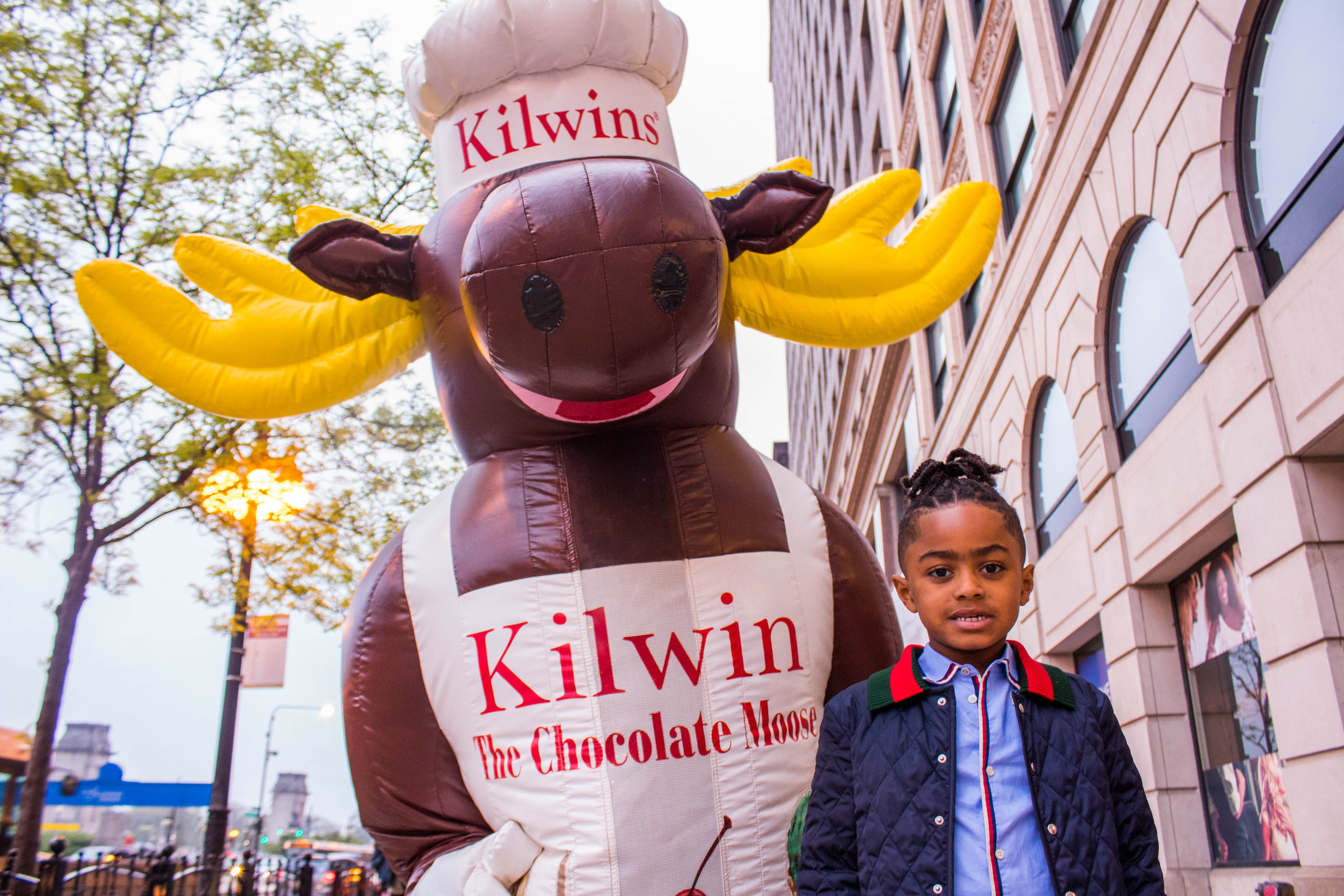 Photo of little girl standing with Kilwins the Moose mascot