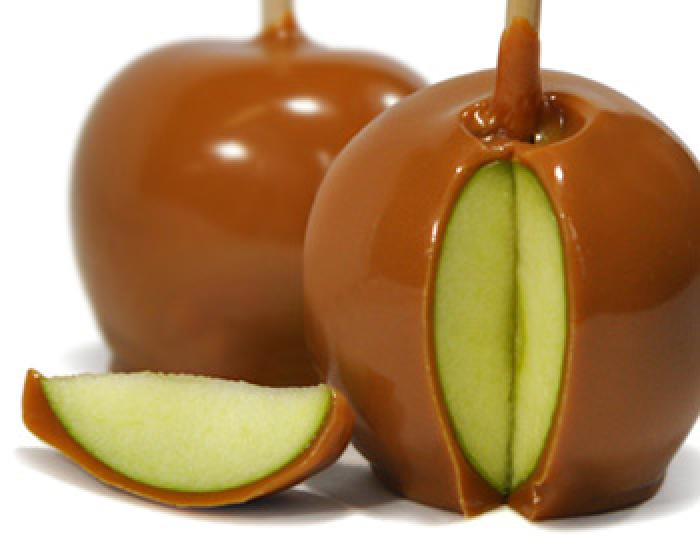 Two caramel covered apples on sticks