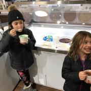 Photo of two children enjoying ice cream at Kilwins