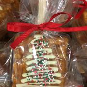 A picture of a Caramel Krispie Treat wrapped for Christmas