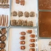 Trays of Caramel and Items Dipped in Caramel
