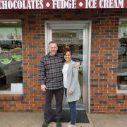 A picture of the owners outside the Grapevine store
