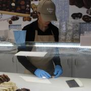 Picture of an employee preparing fudge samples