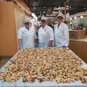 photo of franchisees in front of caramel corn