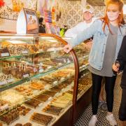 Photo of woman and daughter shopping looking into Chocolates case at Kilwins Chicago on Michigan Ave.