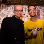 Photo of father and son holding dish of Ice Cream