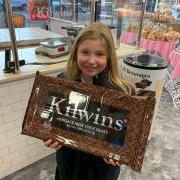 Girl holding giant Kilwins Chocolate Bar