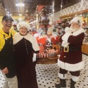 Picture of Santa and Mrs. Claus shopping at Kilwins San Antonio