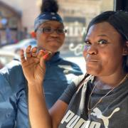 Photo of two women eating Caramel Chews