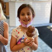Photo of brunette female child holding Ice Cream Cone
