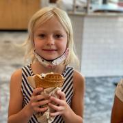 Photo of blonde female child holding Ice Cream Cone