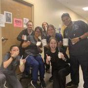 Photo of medical professionals wearing scrubs eating Kilwins Ice Cream