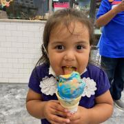 Photo of little girl eating Ice Cream Cone