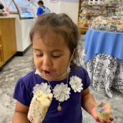 Photo of little girl eating White Chocolate-Dipped Marsh-Mallow with Sprinkles