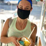 Photo of customer in mask holding Ice Cream