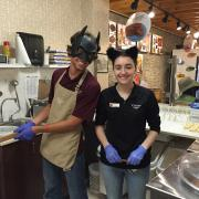 Photo of two employees at Halloween inside the store