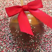 Photo of Chocolate-Dipped Caramel Apple with Sprinkles