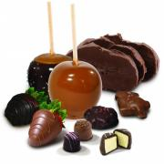Photo of an array of Kilwlins products featuring Fudge, Caramel Apples, Tuttles, Truffles, and Chocolate-Dipped Strawberries