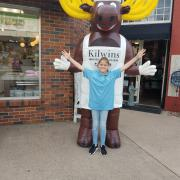 The Kilwins Moose and a friend outside Kilwins Grapevine