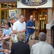 Exterior photo of Kilwins Holland store front with customers