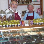 Photo of Kilwins Fort Myers Beach owner & team member behind counter