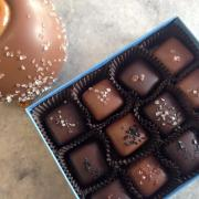 Photo of Sea-Salt Chocolate Caramel Apple and box of Sea-Salt Caramels