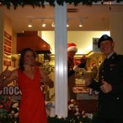 Photo of a man in uniform and a woman in front of the store.