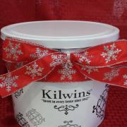 Picture of a Kilwins Tin wrapped for Christmas