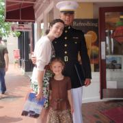 Photo of a man in military uniform, woman and child at Kilwins