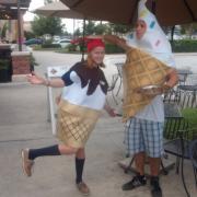 Photo of teenage boy and girl wearing ice cream cone costumes