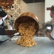 A picture of caramel corn and a copper kettle