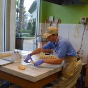Photo of man cutting slices of Fudge
