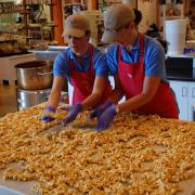 Picture of employees making Peanut Brittle
