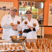 A picture of the owners making Caramel Apples