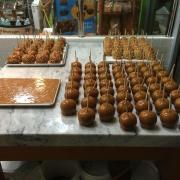 Photo of Caramel Apples on marble table & tray of Caramel