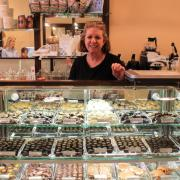A picture of the owner at the Chocolates case