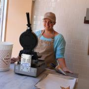 Jill making waffle cones in our front window!  Photo credit: Raj Tawney