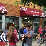 Photo of customers outside the Grand Haven store