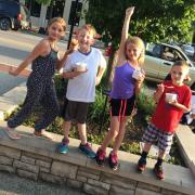 Picture of kids having fun outside the Grand Haven store