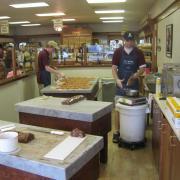 Interior photo of employee making fudge