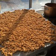 Kilwins Peanut Caramel Corn on the table