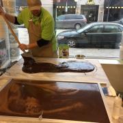 Photo of employee paddling Fudge on marble table