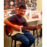 Picture of a man playing the guitar at Kilwins