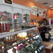 Photo of inside of Kilwins Ft. Myers-Gulf Coast Town Center store showing product displays