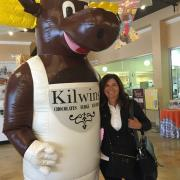 Photo of store owner with Kilwins the Moose mascot