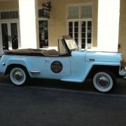 Photo of classic car (Jeepster) with Kilwins logo on the door