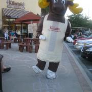Photo of Kilwins the Moose mascot playing hopscotch outside