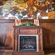 Photo of wall mural and fireplace in Kilwins Wheaton store
